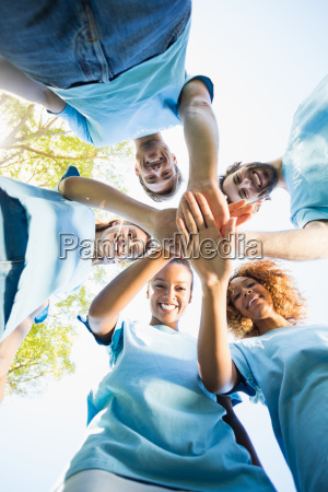 portrait of volunteer group forming huddles