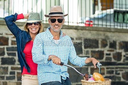 portrait of happy mature couple riding