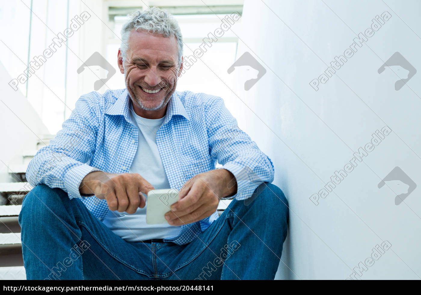 happy, mature, man, using, smartphone, at - 20448141