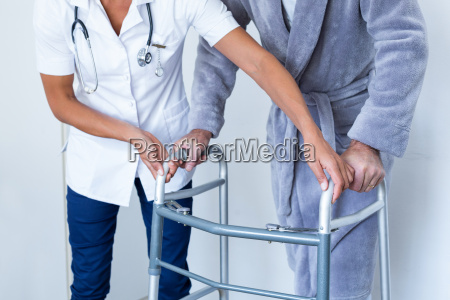 mid section of female doctor helping