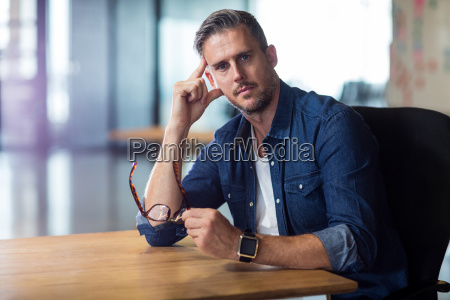 portrait of thoughtful man in office