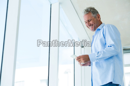 low angle view of smiling man