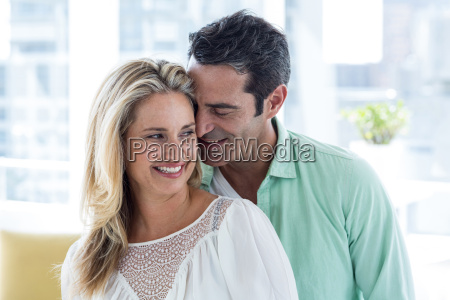 mid adult romantic couple at home