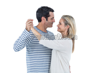 romantic couple dancing against white background