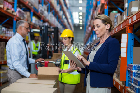 business woman standing in front warehouse