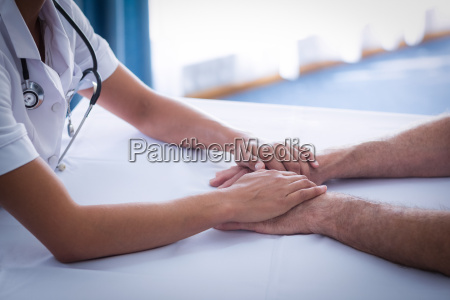 mid section of female doctor consoling