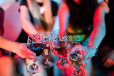 group of friends toasting glass of