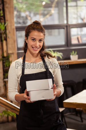 waitress holding boxes with her hands