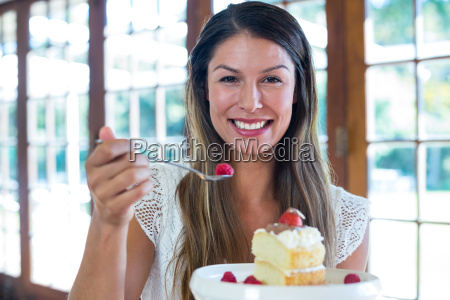 portrait of woman having a pastry