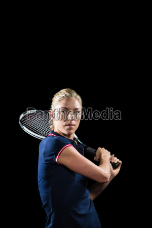 tennis player playing tennis with a