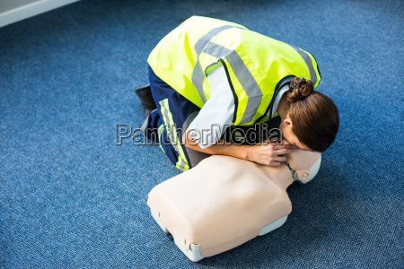 paramedic during mouth to mouth resuscitation