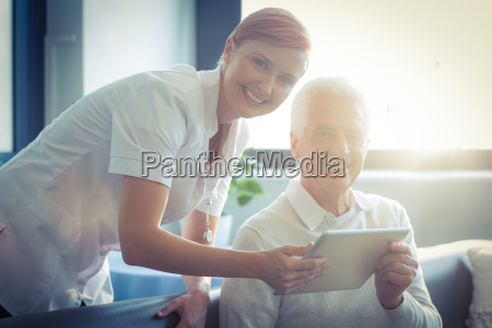 female nurse showing medical report to