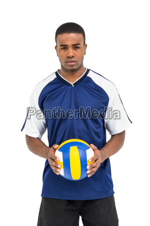 sportsman holding a volleyball