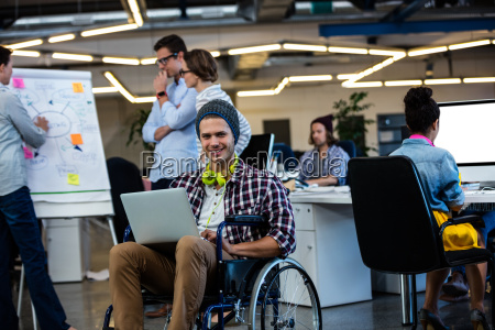 designer in a wheelchair with a
