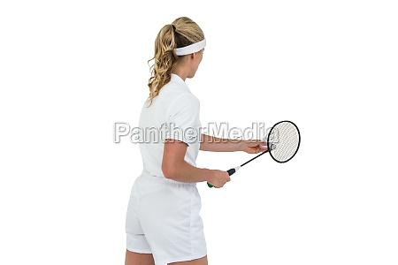 female athlete holding a badminton racquet