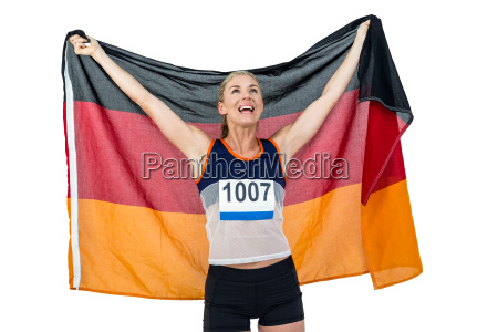 athlete posing with german flag after