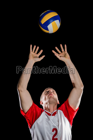 sportsman throwing volleyball while playing