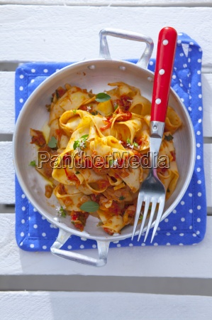 pappardelle pasta with a tomato onion
