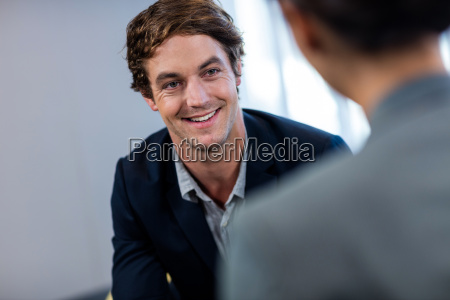 businessman smiling and interacting