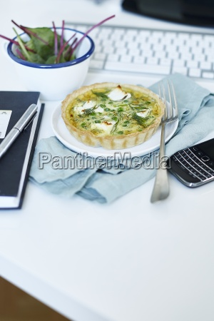 a small quiche with peas and