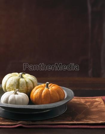 an arrangement of three decorative pumpkins