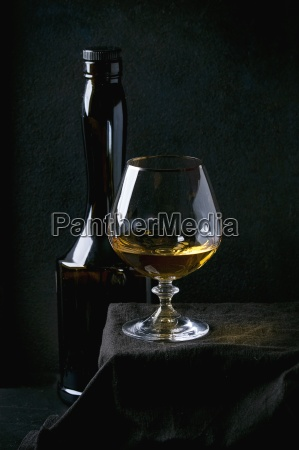 bottle and glass of french apple