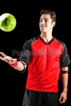 confident athlete man playing with a