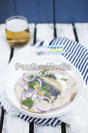 fried herring with homemade crispbread sour