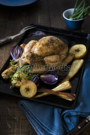 a whole roast chicken with parsnips