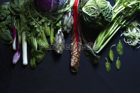 assorted vegetables on a black surface