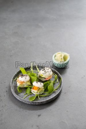 three mini sushi burgers with purslane