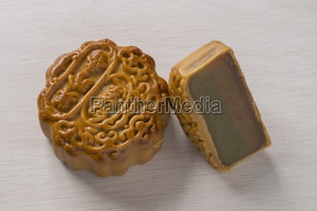 two chinese mooncakes one whole and