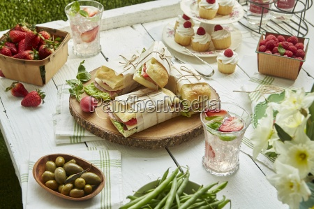 sandwiches salads fruit and cupcakes for