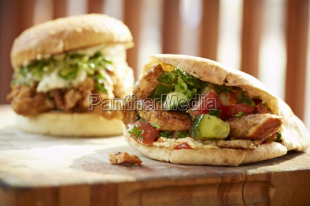 salmon schwarma and a burger with