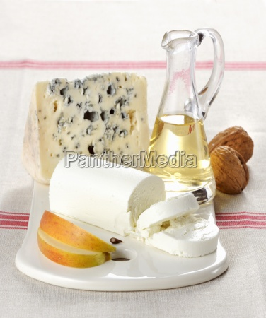 a cheeseboard with goats cheese and