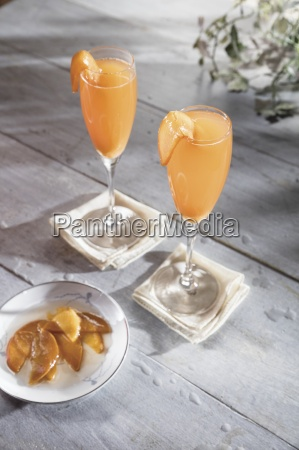 whiskey cocktail in champagne flute with