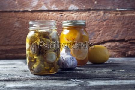 preserved garlic and lemons in mason