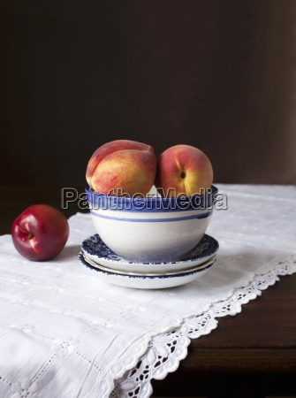 an arrangement of peaches and a