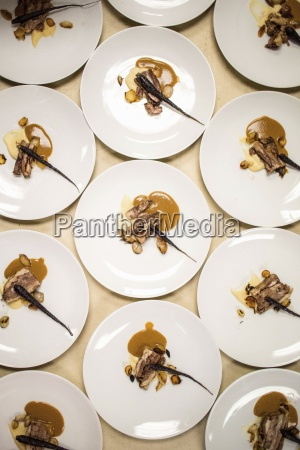 artfully composed main course plates for