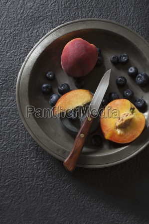 fresh blueberries and peaches on a