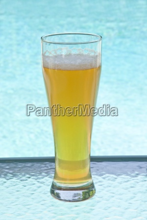 a glass of cold beer by