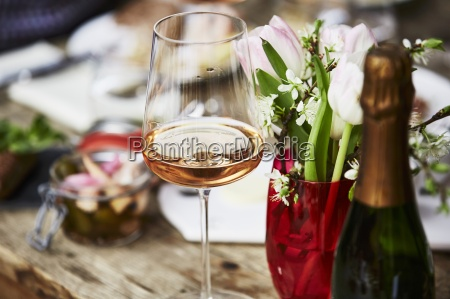 a glass of rose champagne a