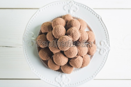 a pile of chocolate pralines on