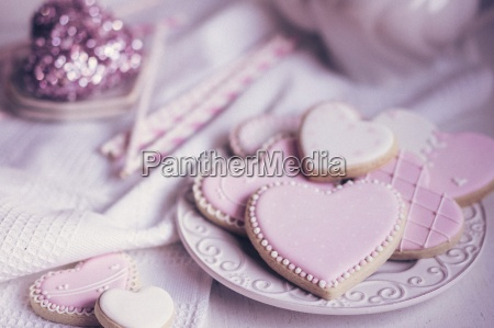pastel coloured heart shaped biscuits on