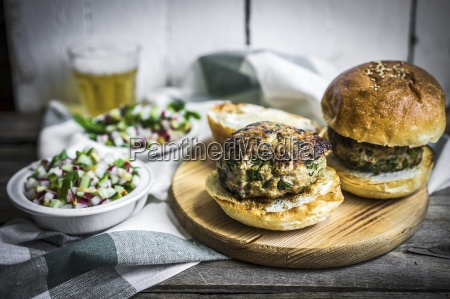 healthy homemade burgers with vegetable salad