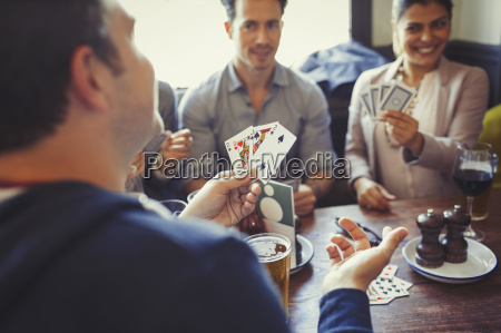 friends playing poker and drinking beer
