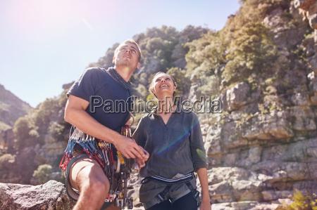 young man and woman rock climbing