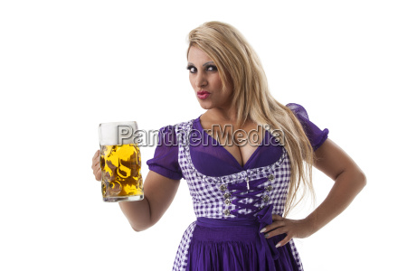 woman in dirndl with a beer