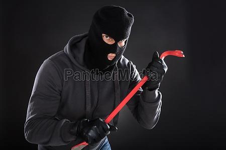 portrait of a burglar with a