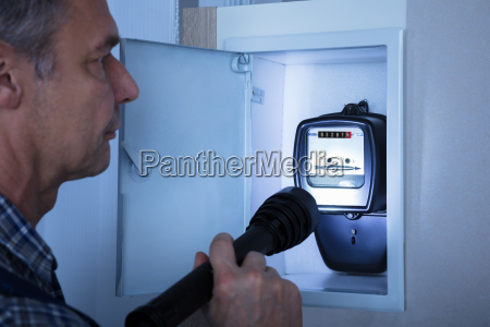 electrician examining a electricity meter